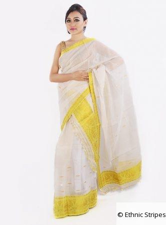 Cream colour mekhela chador with work in yellow